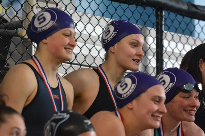 TIMES PHOTO: MATT SINGLEDECKER - The Sunset girls swimming team won two of the three Metro League district title relay races.