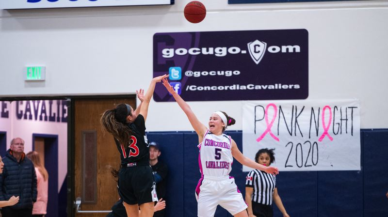 PMG PHOTO: CHRISTOPHER OERTELL - Concordia guard Tamika Etherly (right) challenges a Saint Martin's shot during a game last week at the Northeast Portland university, which has announced it will close at the end of the 2019-20 school year.