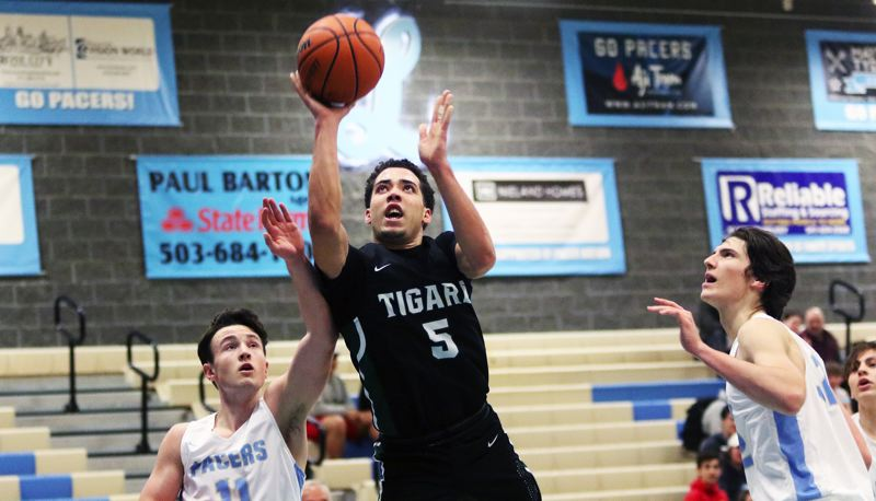 PMG PHOTO: DAN BROOD - Tigard High School junior Drew Carter (5) shoots for two of his game-high 33 points in the Tigers' 71-48 win at Lakeridge on Tuesday.
