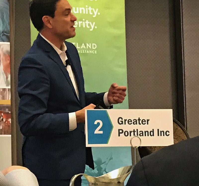 PMG PHOTO: DANA HAYNES - John Tapogna, founder of the Portland-based ECONorthwest consulting firm, discusses the Portland economy and housing at a Portland Business Alliance breakfast.