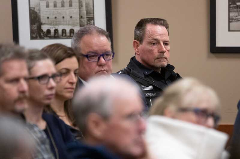 PMG PHOTO: JON HOUSE - West Linn Police Chief Terry Kruger listens to public testimony calling for his firing during a special session of the City Council addressing a racially-charged false arrest in 2017.