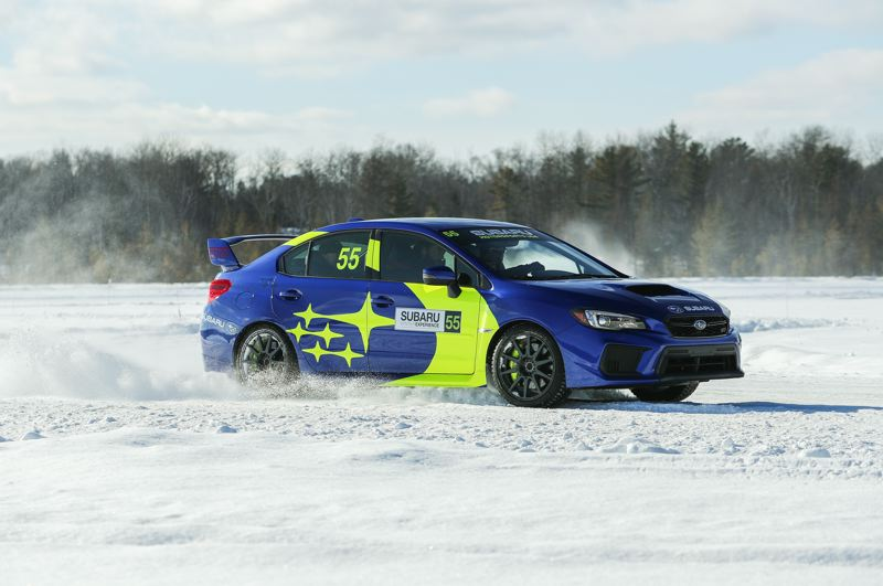 PMG PHOTO: JEFF ZURSCHMEIDE - Ice driving is surprisingly easy with the all-wheel-drive equipped high-performance Subaru WRX and STI.
