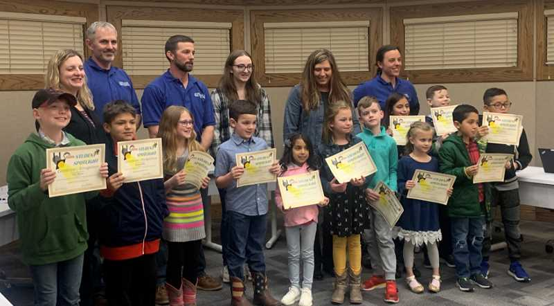 DESIREE BERGSTROM/MADRAS PIONEER - At the Jefferson County 509-J School Board meeting Feb. 10, students from Buff Elementary and Bridges High School received Student Spotlight Awards. Timothy Currier, Addison Skaar, Avery Utz, Alessandra Palacios, Samuel Wilson, Piper Christensen, Julian Yellowtail, Roman Barrara-Vargas, Kekoa Gibons, Delilah Manteiga, Michael Ashley and Tyler Mewes received awards for the highest reading growth from fall to winter, presented by Buff Elementary Principal Billie White.