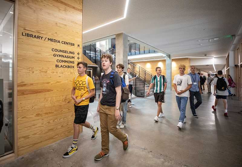 PMG PHOTO: JONATHAN HOUSE - Grant High School students head to classes and assemblies in the remodeled campus during their first day back in August 2019. The Portland School Board is still deciding which schools, if any, should be remodeled with a new 2020 bond measure.
