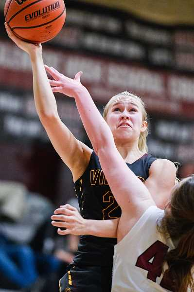 PMG PHOTO: CHRISTOPHER OERTELL - Forest Grove's Amanda Rebsom (23) goes up for a shot during a girls basketball game at Glencoe High School in Hillsboro, Ore., on Tuesday, Feb. 18, 2020.