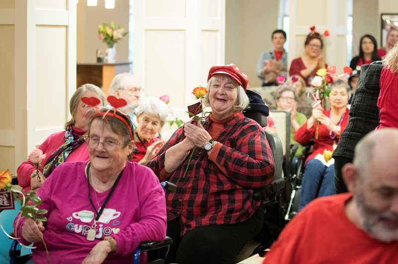 PMG PHOTO: JAIME VALDEZ - Residents of Marquis Wilsonville were celebrating Valentine's Day when the students came to perform.
