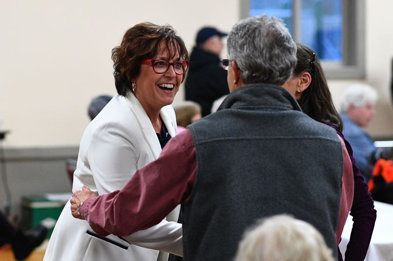 PMG PHOTO: CHRISTOPHER OERTELL - North Plains Mayor Teri Lenahan meets with attendees before the annual State of the City address at the Jessie Mays Community Center on Tuesday, Feb. 18.
