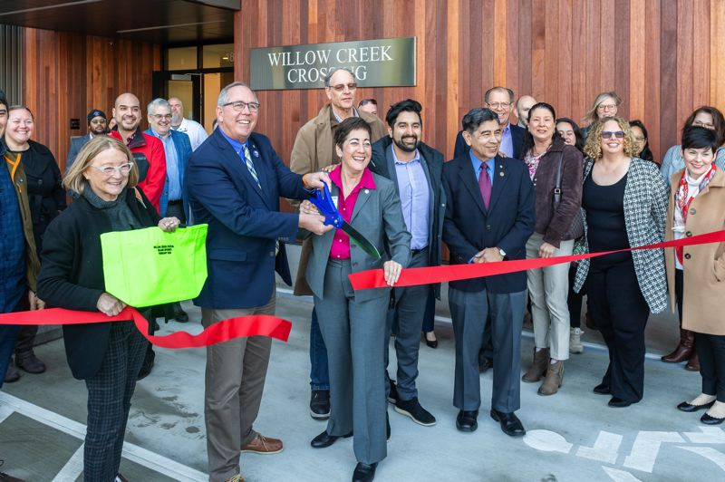 PMG PHOTO: CHRISTOPHER OERTELL - Hillsboro Mayor Steve Callaway cuts the ribbon with other local elected officials during a grand opening ceremony at the new Willow Creek Crossing Apartments in Hillsboro on Wednesday, Feb. 19.