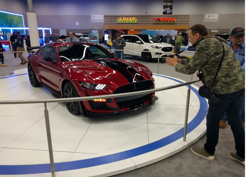 PMG PHOTO: JIM REDDEN - Fans are eager to get pictures of the newest version of the Shelby 500 GT Mustang at the Portland International Auto Show.