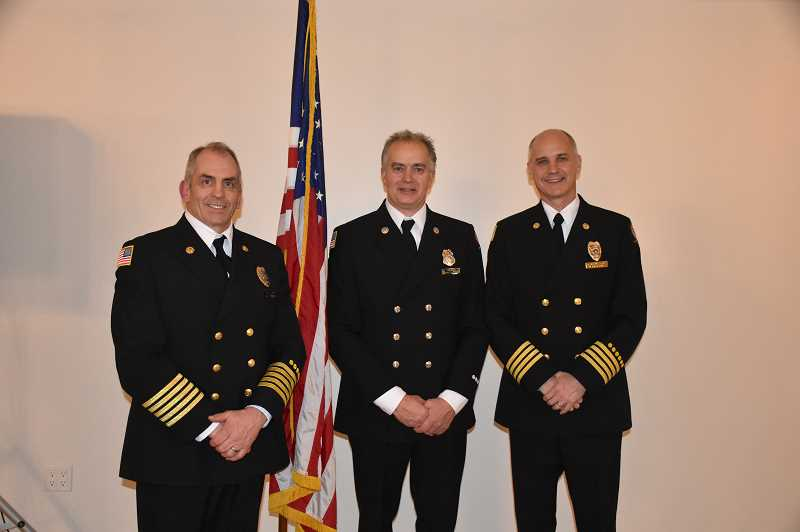 WOODBURN FIRE DISTRICT - Left to right, Woodburn Fire Chief Joe Budge, Firefighter of the Year Scott Mateson, and Division Chief of Training and Operations Scott Heesacker.