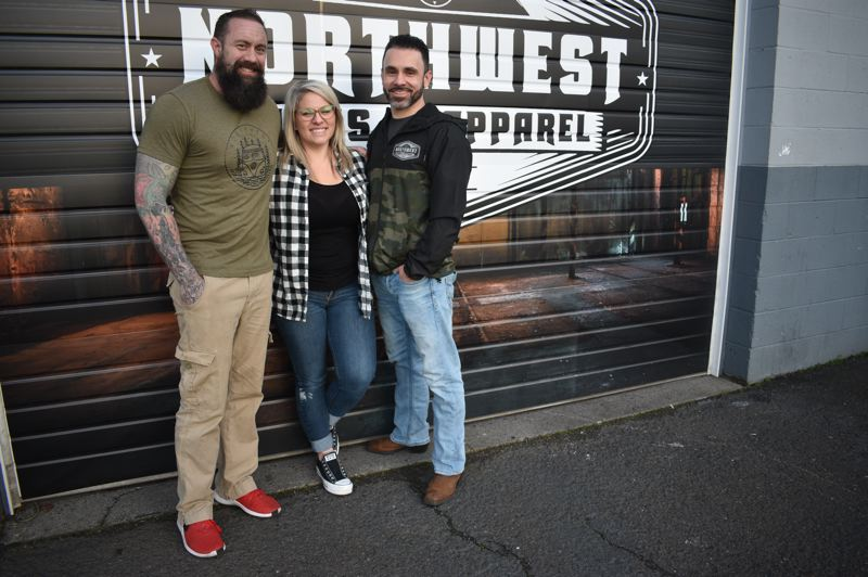 PMG PHOTO: SHANNON O. WELLS - Chris Brittain, left, started what became Northwest Signs & Apparel 20 years ago, bringing on partners Brittany Brittain and Rob Faria, far right, about a year ago.