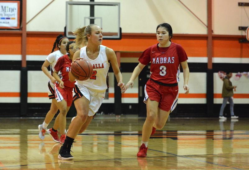 PMG PHOTO: DEREK WILEY - Molalla senior Maddy Lisac scored 15 points Thursday night against Madras.