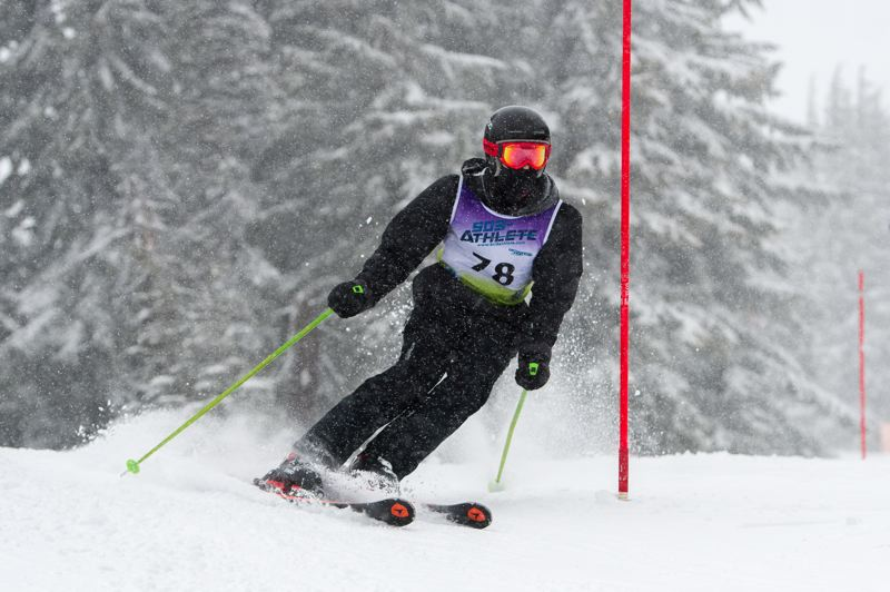 COURTESY PHOTO: MIKE JULIANA - Sherwood High School's Austin Burr competes in the Metro League slalom ski race held on Feb. 15.