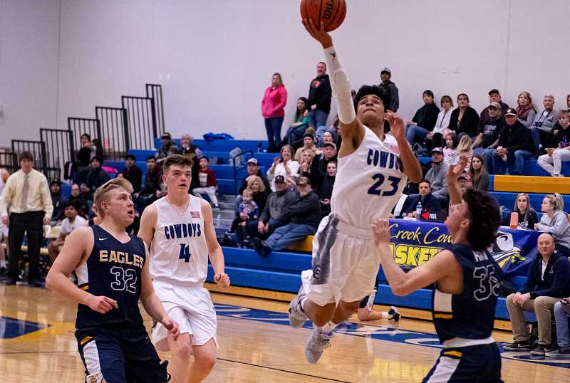LON AUSTIN/CENTRAL OREGONIAN - Kevin Sanchez flies to the hoop against Hood River Valley in January as the Cowboys earned a two-point victory over the Eagles. Tuesday, in Hood River, Sanchez scored 25 points as the Cowboys rolled to a 73-57 victory over Hood River Valley.