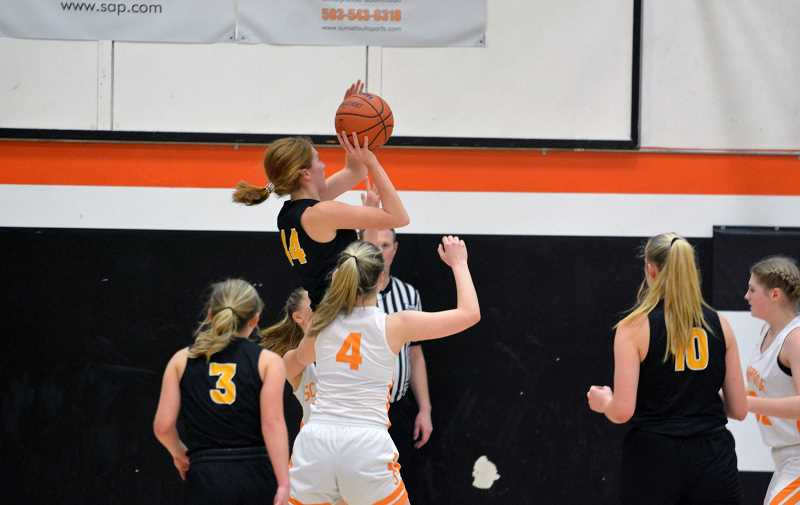 PMG FILE PHOTO - St. Helens senior Maddie Holm scored 30 points in her last ever game against Scappoose.