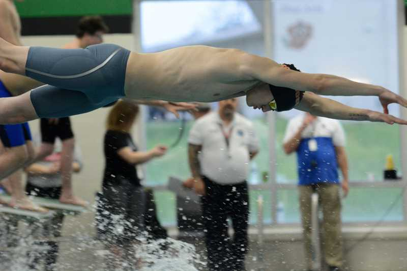 PMG PHOTO: DEREK WILEY - The Scappoose boys swimming team took second at the Northwest Oregon Conference District meet.
