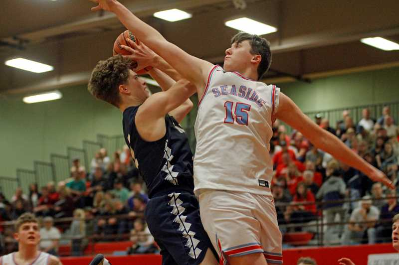 PMG PHOTO: WADE EVANSON - Banks' Jarred Evans goes up for a shot during the Braves' game against Seaside Thursday night, Feb. 20, at Seaside High School.