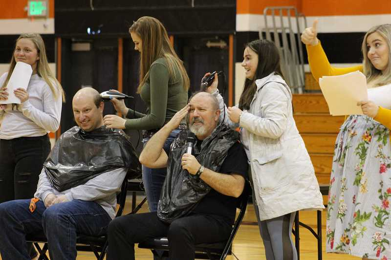 PMG PHOTO: KRISTEN WOHLERS - MHS staff members get their heads shaved for the cause.