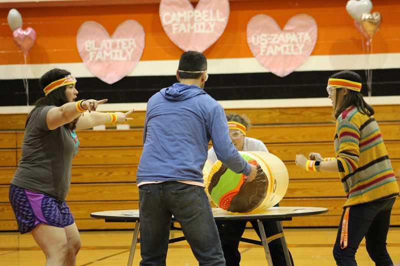 PMG PHOTO: KRISTEN WOHLERS - MHS staff members duke it out in a game involving giant burritos.