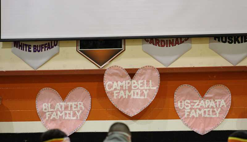 PMG PHOTO: KRISTEN WOHLERS - Heart posters remind students, staff and guests that this is all for three families: the Blatter family, Campbell family and Us-Zapata family.