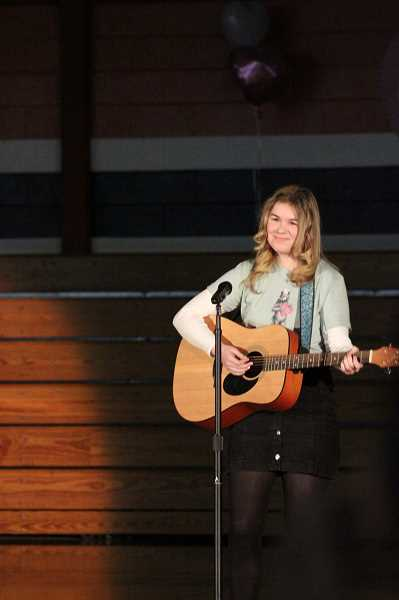 PMG PHOTO: KRISTEN WOHLERS - Jenna Langendorfer sings her original song, 'You will make it Out' at the closing assembly.