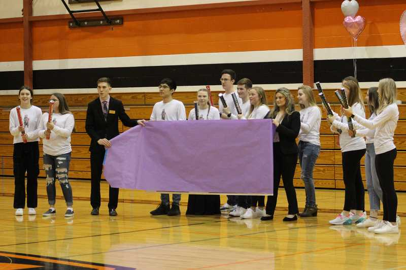 PMG PHOTO: KRISTEN WOHLERS - Students prep for the big reveal.