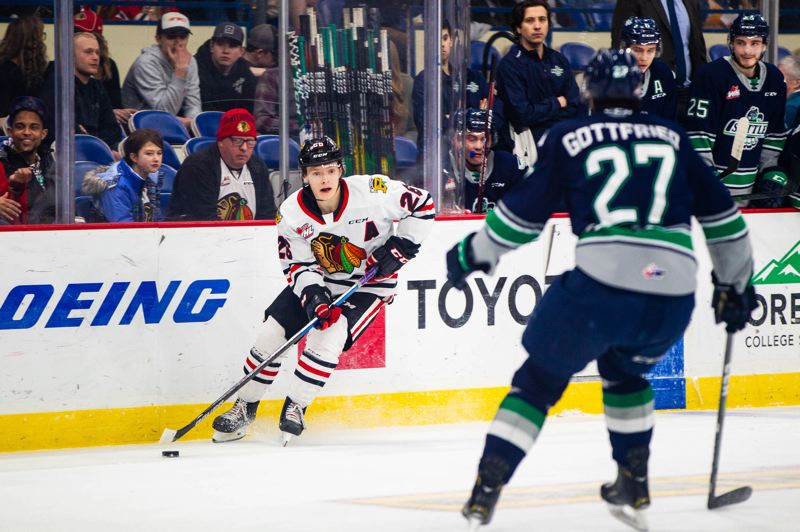 COURTESY PHOTO: MATT WOLFE/PORTLAND WINTERHAWKS - Mason Mannek carries the puck up ice during Portland's 5-3 Friday win over Seattle. Mannek scored the go-ahead goal early in the third period.