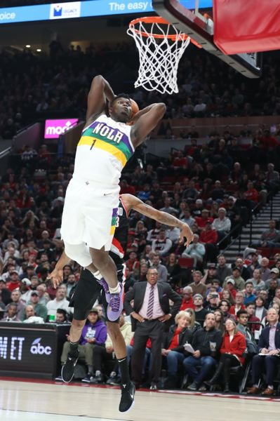 PMG PHOTO: JAIME VALDEZ - Zion Williamson, rookie forward, slams for two points as the New Orleans Pelicans defeat the host Trail Blazers on Friday night.