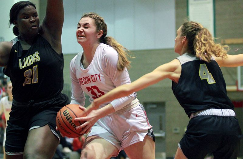 PMG PHOTO: MILES VANCE - Oregon City junior Emmaly Welch drives to the basket during her team's 52-49 overtime loss to West Linn at Oregon City High School on Friday, Feb. 21.
