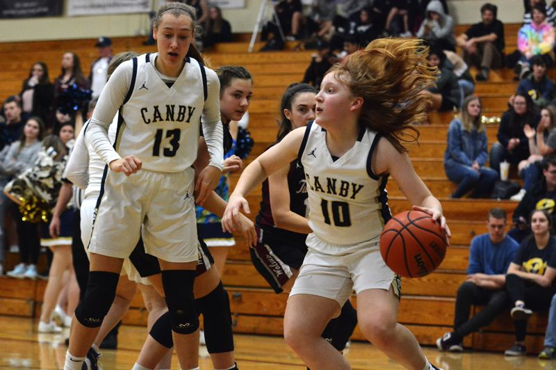 PMG PHOTO: DEREK WILEY - Canby's Allie Mead, No. 10, and Ally Odell, No. 13, each scored 10 points Friday night against Tualatin.