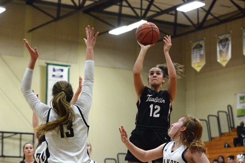 PMG PHOTO: DEREK WILEY - Tualatin junior Sidney Dering, who scored a game-high 17 points, shoots the ball at Canby High School Friday night.