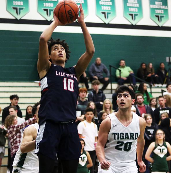 PMG PHOTO: DAN BROOD - Lake Oswego High School junior post Trace Salton (10) goes up to the basket during the Lakers' league game at Tigard on Friday.