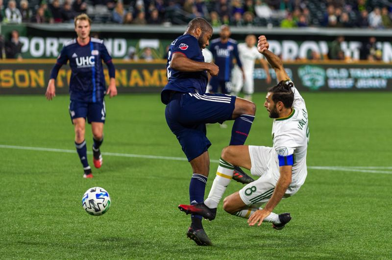 PMG PHOTO: DIEGO DIAZ - Diego Valeri (8) and the Timbers were largely contained by Andrew Farrell and the New England Revolution in Saturday's 3-1 win for the Revs on Saturday at Providence Park.