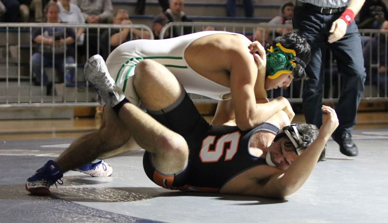 PMG PHOTO: JIM BESEDA - Putnams Kevin Villa needed only 18 seconds to put Scappooses Brett Krieger on his back and lock up the 195-pound title at Saturdays Northwest Oregon Conference district wrestling championships at Wilsonville High School.