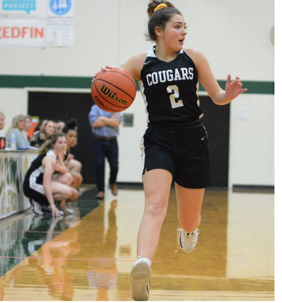 PMG PHOTO: DAVID BALL - Country Christians Lanie Barden dribbles down the sideline on a fastbreak during the Cougars 47-41 loss to Damascus Christian in the Valley 10 title game Saturday.