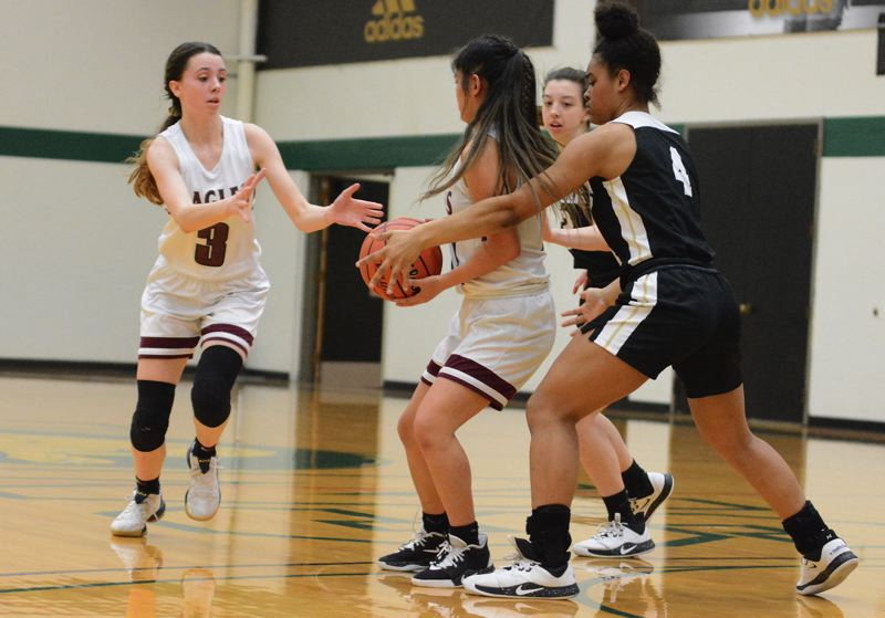 PMG PHOTO: DAVID BALL - Damascus Christians Emily Powers circles around to take a hand off from teammate Ally Love during the Eagles 47-41 win over Country Christian in Saturdays Valley 10 title game.