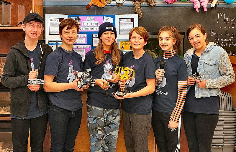 DAVID F. ASHTON - Holding their trophies and their robot, these Amazing Walri had a good season, say teammates Hunter Boyer, Calvin Beall, Korbin Towne, Eli Bates, Frances Springgate, and Jenna McComas. All are Winterhaven School eighth graders.