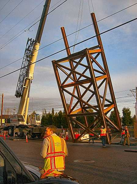 RITA A. LEONARD - TriMet's Tyler Graf joined THE BEE in watching the south support tower for the new overcrossing being raised January 27.