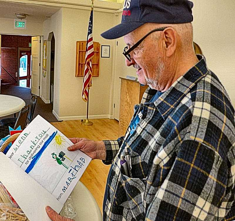 COURTESY OF SARA KIRSCHENBAUM - After his fifty-year celebration, USPS mailman Glenn Forayter lingered to enjoy the collection of congratulations and thank you cards made for him by preschool children attending Woodstocks Homestead Schoolhouse.