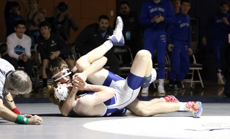 PMG PHOTO: JIM BESEDA - Hillsboro's Jackson Godsey wrestles during the NWOC District Wrestling Championships this past Friday and Saturday, Feb. 21-22, at Wilsonville High School.