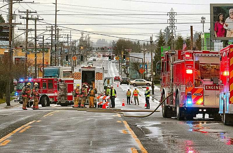 DAVID F. ASHTON - Natural gas, escaping from a damaged main line, closed S.E. 82nd Avenue of Roses to all traffic for hours on January 23rd.