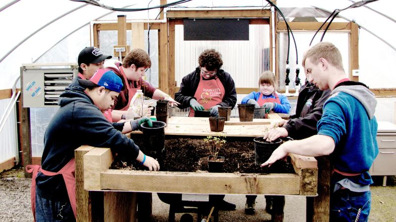 COURTESY PHOTO: BILL PETERSON  - The inaugural class for Main City Flora, a program that cultivates students love of working with plants within a newly constructed greenhouse.