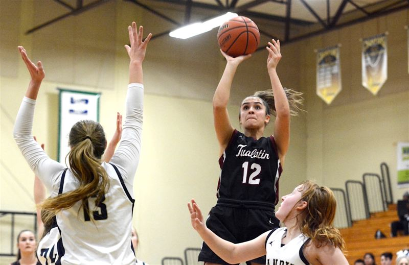 PMG PHOTO: DEREK WILEY - Tualatin High School junior Sidney Dering,(12)  who scored a game-high 17 points, shoots the ball Friday night at Canby High School.