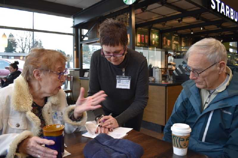COURTESY PHOTO - Discussing the advantages of membership in Rivers East Village are left to right, Kay Weaver, Sonya Norton and Joe Mozena.