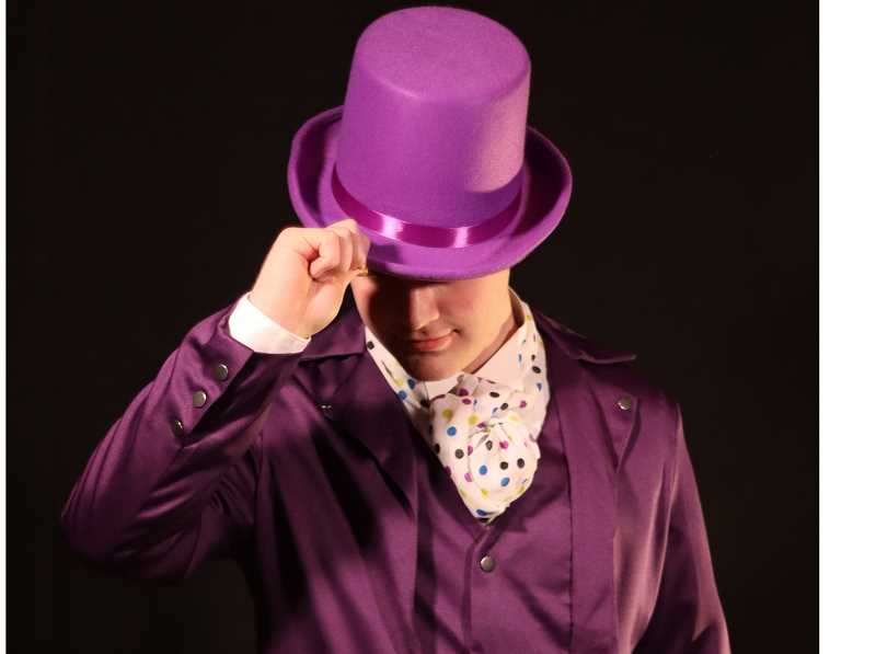 COURTESY PHOTO - Wearing the iconic purple suit, Willie Wonka (Isaac Elmore) tips his hat in 'Charlie and the Chocolate Factory.'