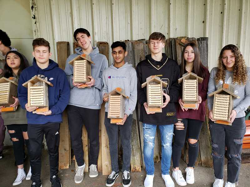 COURTESY PHOTO - Construction students show off the mason bee houses they built for the Gladstone Nature Park's pollinator hill project.