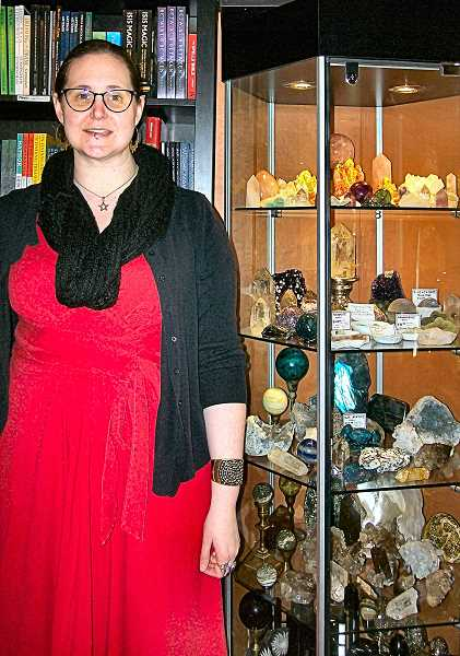RITA A. LEONARD - Ravens Wing General Manager Iris Meredith Bell stands with some of the Sellwood shops collection of books, cards, and stones.