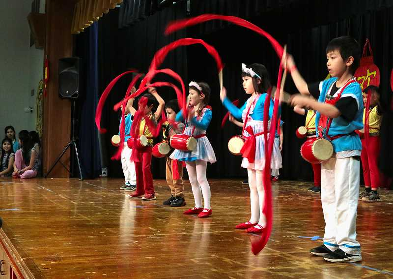 DAVID F. ASHTON - Concluding a Chinese dance number were students in the Woodstock Elementary Schools Mandarin Immersion Program during this years Lunar New Year festival.