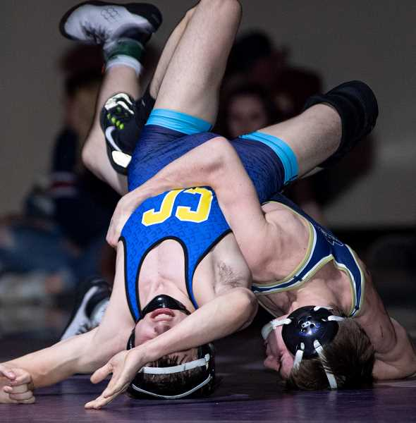 LON AUSTIN/CENTRAL OREGONIAN - Steven Ware, right, works to put teammate Tannon Joyner on his back during the district finals at 120 pounds. Ware went on to win 11-3. Both Crook County wrestlers qualified for the state meet.