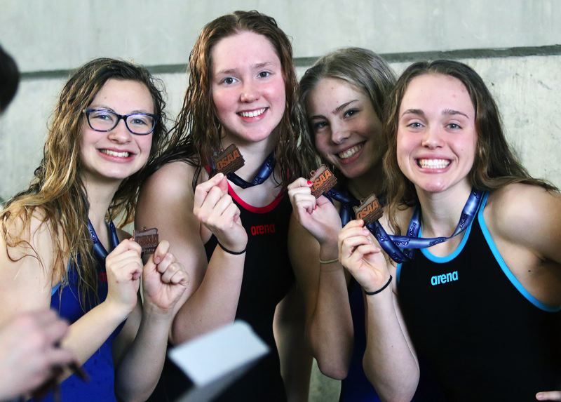 PMG PHOTO: DAN BROOD - The Tualatin team of (from left) Erika Farring, Abi Karsseboom, Izzy Ehmig and Britney Muralt finished in eighth place in the 200-yard medley relay at the Class 6A state swimming championships.